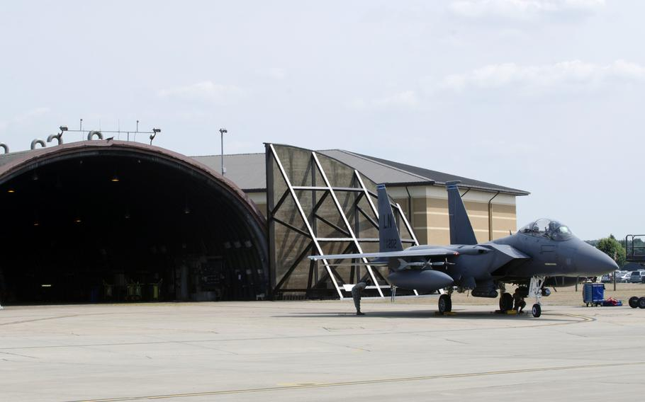 Engines running, an F-15E Strike Eagle sits outside at RAF Lakenheath, England, on Tuesday, July 16, 2013. The Air Force received approval to reallocate some funds, restoring flight time to combat aircraft around the world.