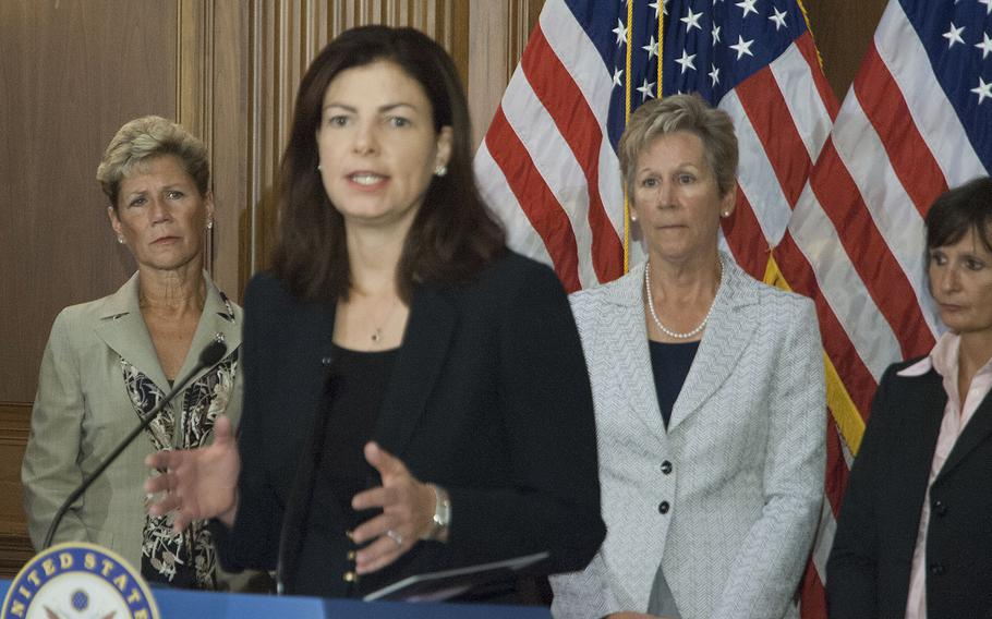 Sen. Kelly Ayotte, R-N.H., (center) and Sen. Claire McCaskill, D-Mo., spoke to reporters Thursday about proposed legislation to address sexual assault prosecutions in the military.