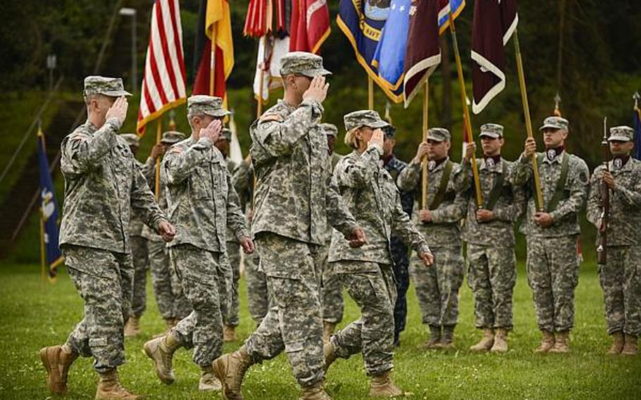 U.S. Army Col. John P. Collins, from left to right, Brig. Gen. Jeffrey B. Clark, Col. Eric Sones and Lt. Gen. Patricia D. Horoho inspect the troops during a command relinquishment ceremony at the Europe Regional Medical Command Tuesday, July 30, 2013, at Sembach Kaserne, Germany.