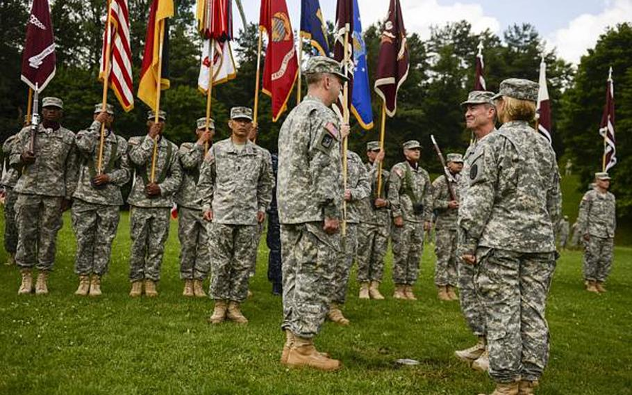 U.S. Army Col. John P. Collins, front left, prepares to assume temporary command of Europe Regional Medical Command from Brig. Gen. Jeffrey B. Clark, middle, as Lt. Gen. Patricia D. Horoho, the Army Surgeon General, presides as the reviewing officer at a ceremony Tuesday, July 30, 2013, at Sembach Kaserne, Germany.
