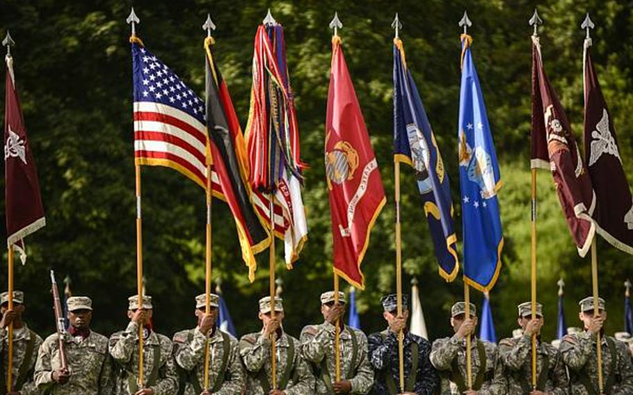 The multi-service color guard performs at a command relinquishment ceremony at Europe Regional Medical Command on Tuesday, July 30, 2013, at Sembach Kaserne, Germany.
