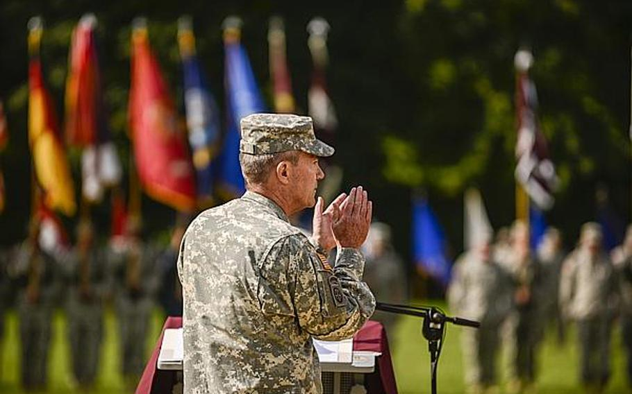 U.S. Army Brig. Gen. Jeffrey B. Clark, speaks during a ceremony at which he relinquished command of Europe Regional Medical Command on Tuesday, July 30, 2013, at Sembach Kaserne, Germany.