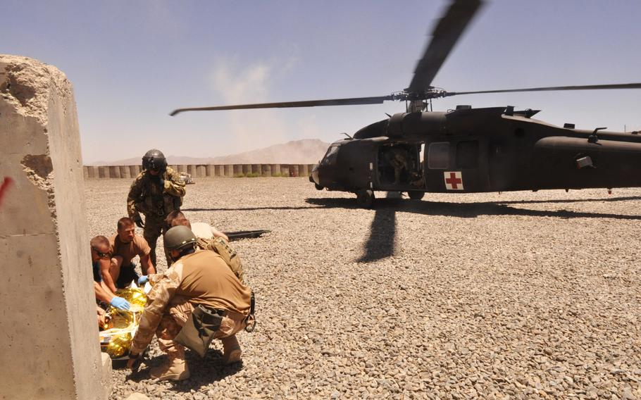 U.S. and Czech medics prepare to medevac a young Afghan boy who was hit by a stray bullet at Combat Outpost Soltan Kheyl. The young boy died when he reached FOB Shank, a forward operating base with a higher level of medical care.
