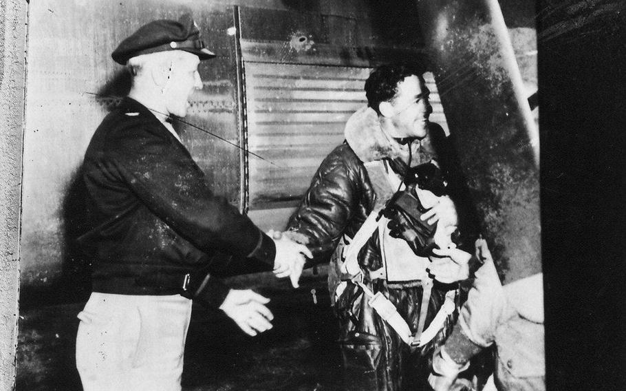 Each B-24 crew was required to complete 30 missions — but few did. In the first months of the 448`s operations, more than half the 448th`s crews perished. Then-Lt. Leroy Engdahl was the first pilot to complete all his 30 missions for the 448th, in May 1944, and later on was integral to establishing the 448th`s memorial at Seething and helping Everson find addresses for the veterans. Pictured, he has just finished his 30th mission — shortly after, the base dressed him in pajamas, plied him with whiskey and paraded him around the base to help morale.