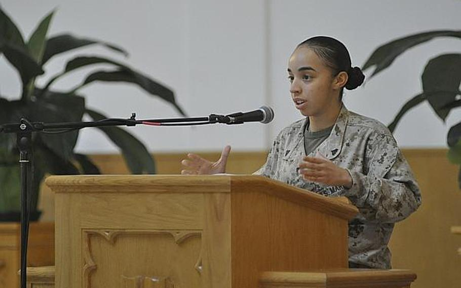 Marine Cpl. Andrea Arenas Vazquez speaks during a memorial service for her cousin, Petty Officer 2nd Class Naem Igrayeb, in Naples, Italy, on Friday, Sept. 6, 2013. Igrayeb, 25, an information systems technician from Brooklyn, N.Y., died in a motorcycle accident last week in a Naples suburb.