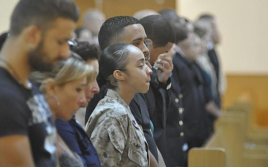 Marine Cpl. Andrea Arenas Vazquez reacts during the roll call at a memorial service for her cousin, Petty Officer 2nd Class Naem Igrayeb, in Naples, Italy, on Friday. Igrayeb, 25, an information systems technician from Brooklyn, N.Y., died in a motorcycle accident last week in a Naples suburb.