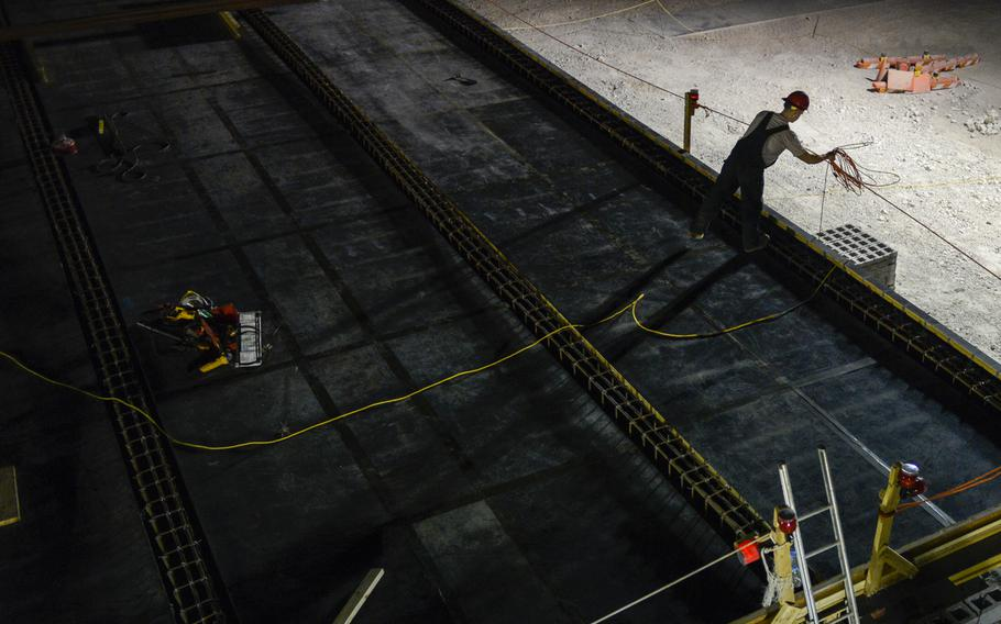 A member of the 557th Expeditionary Red Horse Squadron builds a 20-bed Contingency Aeromedical Staging Facility at an undisclosed location in Southwest Asia. The building will become a hub for seriously injured U.S. personnel in the Middle East once America withdraws the bulk of its forces from Afghanistan.