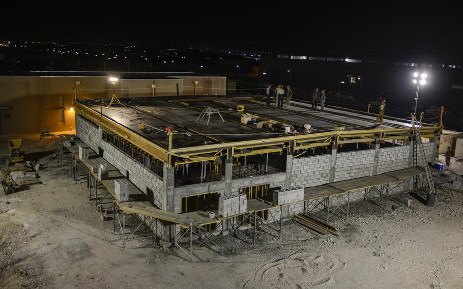 Members of the 557th Expeditionary Red Horse Squadron build a 20-bed Contingency Aeromedical Staging Facility at an undisclosed location in Southwest Asia. The building will become a hub for seriously injured U.S. personnel in the Middle East once America withdraws the bulk of its forces from Afghanistan.