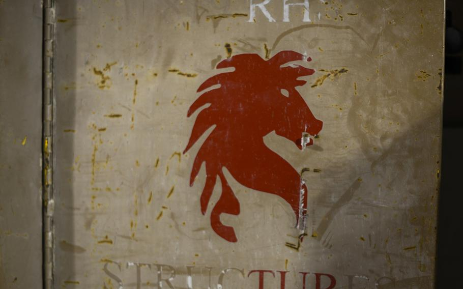 """A """"Red Horse"""" sticker identifies a tool box belonging to the 557th Expeditionary Red Horse Squadron sitting on a building site at an undisclosed location in Southwest Asia."""