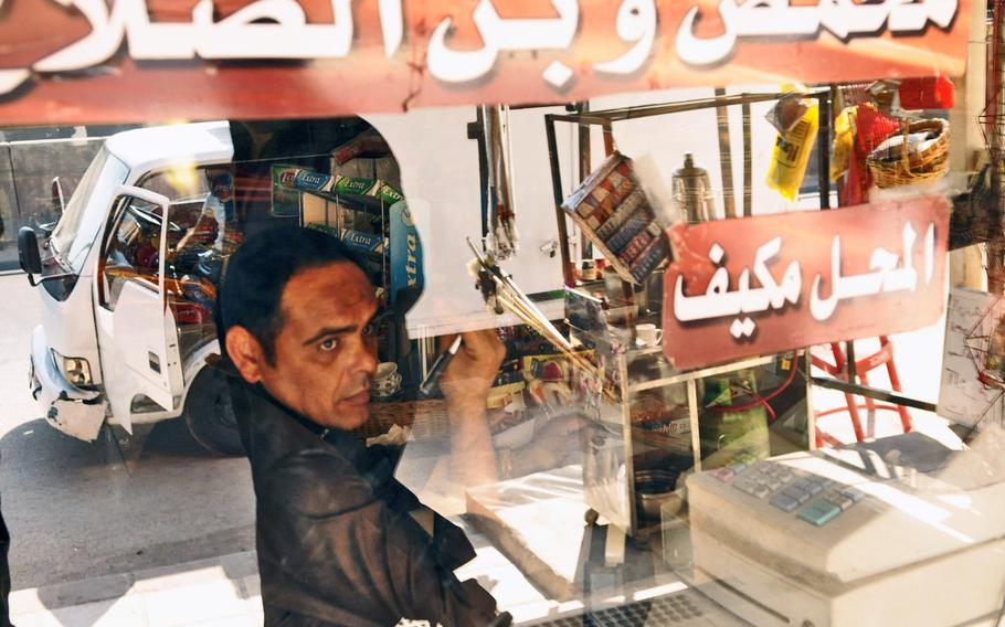 A Palestinian man inside his shop in the Baqa'a refugee camp in Jordan.