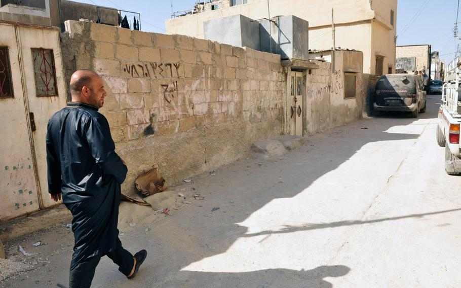 Muhammad Halaweh, a Palestinian by descent, walks down a street in the Baqa'a refugee camp near Amman Jordan.Halaweh said he worries that Syrian refugees are becoming the priority for the Jordanian government, and services the Palestinians have always received will eventually be transferred to the Syrians.