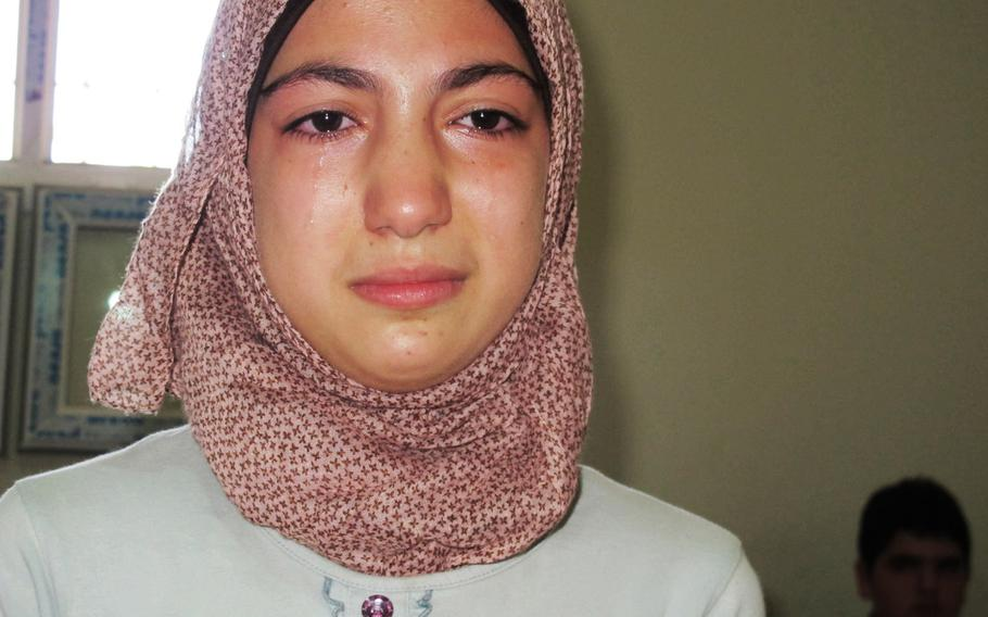 Tears stream down 13-year-old Aaliyah's face as the 7th-grader from Idlib, Syria, describes her experiences in the war on Sept. 16, 2013, the first day of school for Syrian refugee children in the border city of Antakya, Turkey.