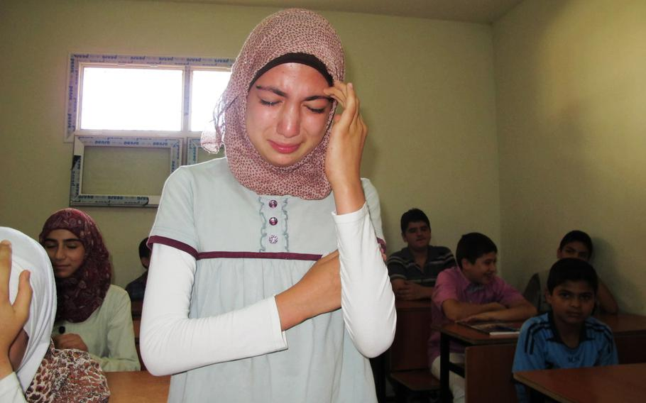 Aaliyah, a 13-year-old 7th grader from Idlib, Syria, loses her composure as she describes her experiences in the war during the first day of school for Syrian refugee children in the border city of Antakya, Turkey.