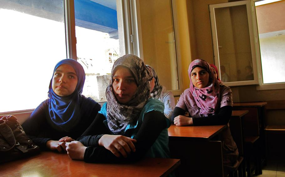 Fatima, left, Zahara, center, and Noor, all 14 from Hamah, Syria, described the suffering they endured in their home country. Fatima said that her uncle was killed by regime forces before he got to see his 2-day-old baby.
