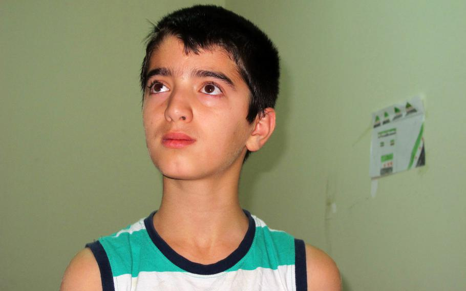Osama, a 12-year-old from Hamah, Syria, who is attending the Human Essence First School in Antakya, Turkey, says forces loyal to President Bashar Assad killed his father.