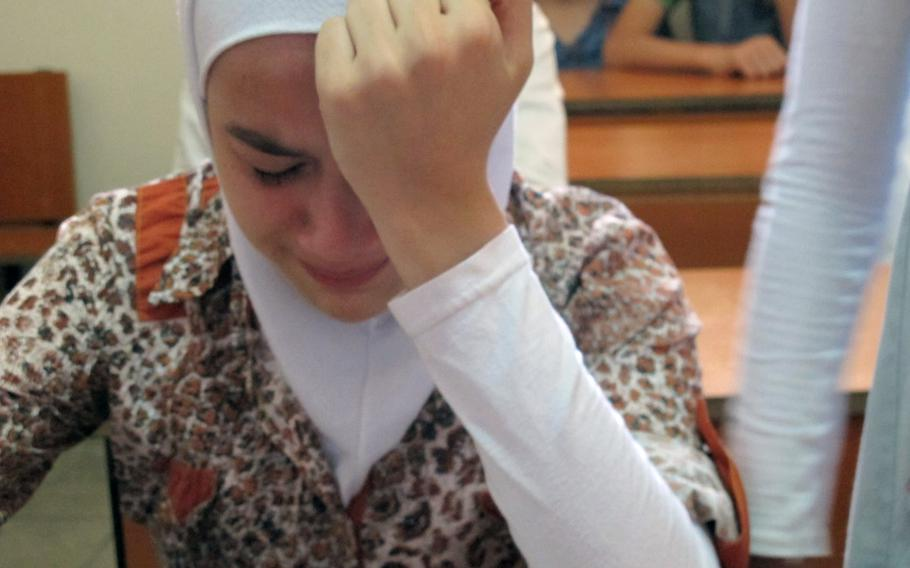 A 13-year-old girl breaks down in class on her first day at the Human Essence First School for Syrian refugee children in Antakya, Turkey, on Monday, Sept. 16, 2013. Teachers said that almost all of the students in the school suffer psychological issues.