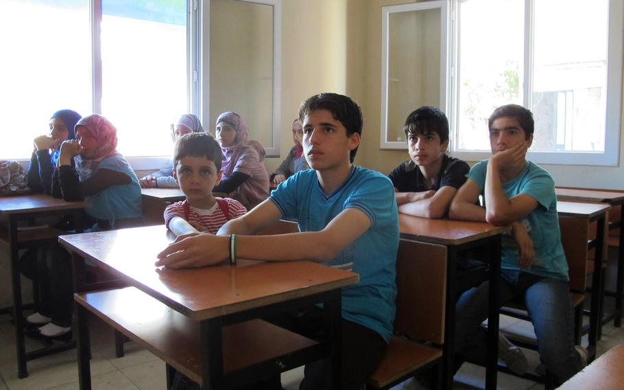 A class of 14 year olds at the Human Essence First School for Syrian refugees in the Turkish city of Antakya on their first day of school on Monday, Sept. 16, 2013.