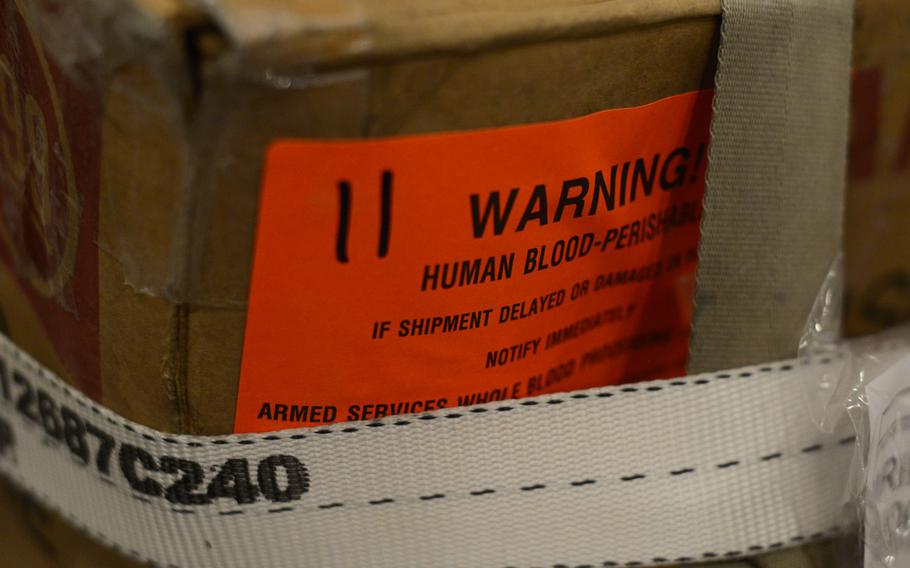 A shipment of blood products sent from the U.S. waits to be offloaded from a Boeing 747 and processed through the 379th Air Expeditionary Wing's blood trans-shipment center at an Air Force base in Southwest Asia on its way to medical facilities in Afghanistan.