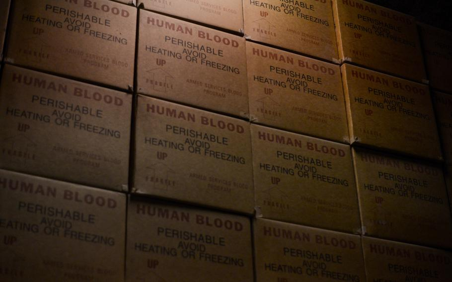 Boxes used to transport blood from the U.S. to Afghanistan sit neatly stacked in the blood trans-shipment center at an Air Force base in Southwest Asia.