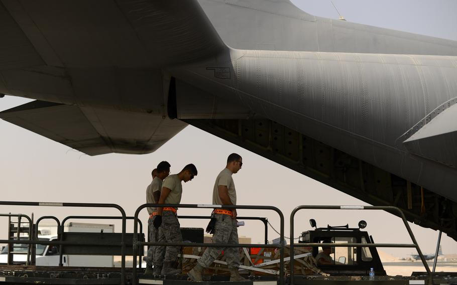 Servicemembers with the 8th Expeditionary Air Mobility Squadron load cargo, including a pallet of blood, onto a C-130 Hercules from an Air Force base in Southwest Asia on Sept. 13, 2013.