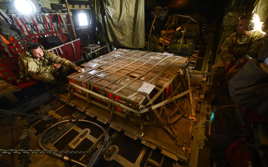 A palletized shipment of blood originating in the U.S. sits in the back of a C-130 Hercules in the care of loadmasters with the 746th Expeditionary Airlift Squadron Master Sgt. Jason Harvey, left, and Master Sgt. Tessa Tolle as it makes its way to U.S. military field hospitals in Afghanistan.