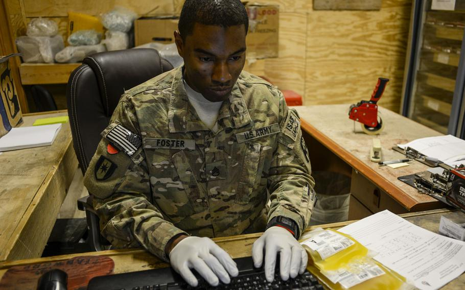 Staff Sgt. George Foster processes platelets for shipment from Kandahar Air Field, Afghanistan to U.S. military field hospitals in Regional Command South on Sept. 14, 2013.
