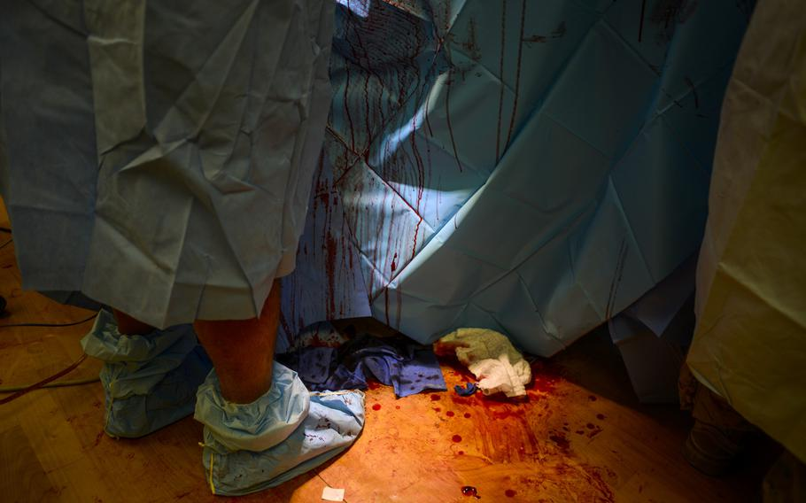Capt. James Bates operates on an Afghan soldier, injured in a rocket-propelled grenade attack, at a U.S. military field hospital at Forward Operating Base Apache in Southern Afghanistan's Zabul Province, on Sept. 17, 2013.