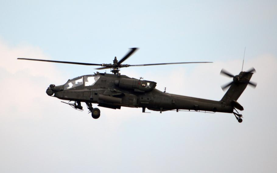 U.S. Army AH-64 Apache attack helicopter flies over Camp Humphreys, South Korea on Oct. 10, 2013.