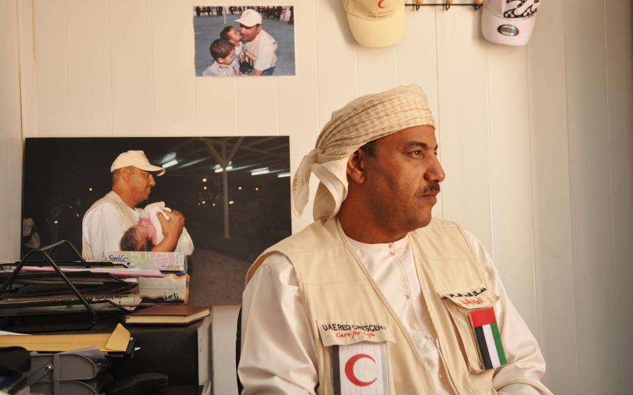 """Saif Ali al-Dahri in his office at a camp for Syrian refugees he manages. The camp is un by the United Arab Emirates Red Crescent Society. The camp is nicknamed the """"five star""""because it has a higher level of services."""