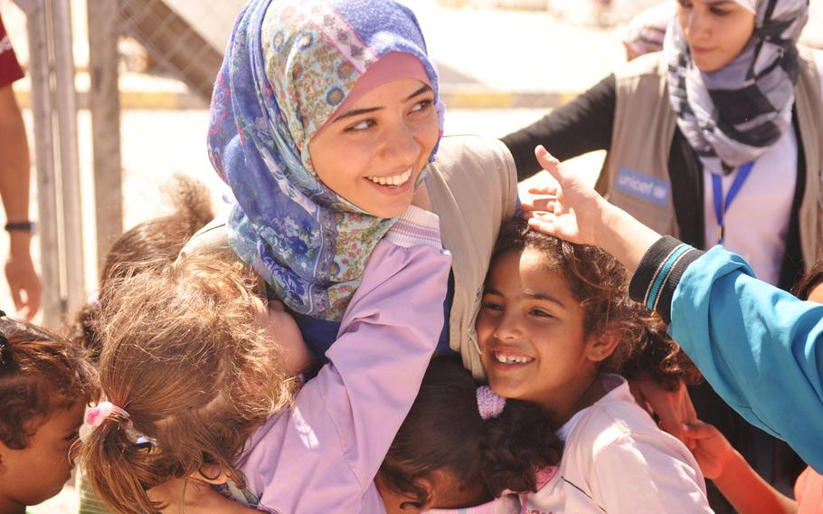 Enas Salim provides psychological support for children living at a camp for Syrian refugees in Jordan that is funded and run by the United Arab Emirates Red Crescent Society.