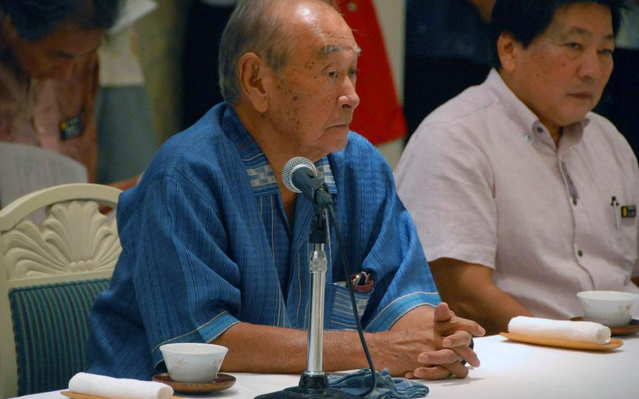 Okinawa Gov. Hirokazu Nakaima, shown here during a meeting in October, is expected to decided this winter whether to allow new offshore runways to be built as a replacement base for Marine Corps Air Station Futenma.