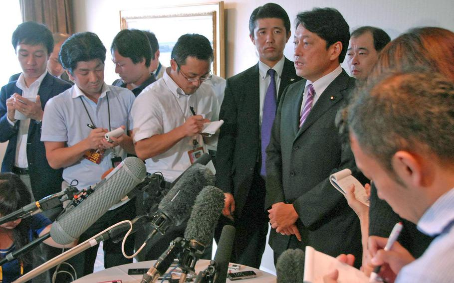 Japan Defense Minister Itsunori Onodera speaks with the press following a meeting Oct. 8 with Okinawa Gov. Hirokazu Nakaima about relocating Marine Corps Air Station Futenma. Tokyo has offered a series of concessions to Okinawa in recent weeks in hopes of smoothing the approval of the controversial project.