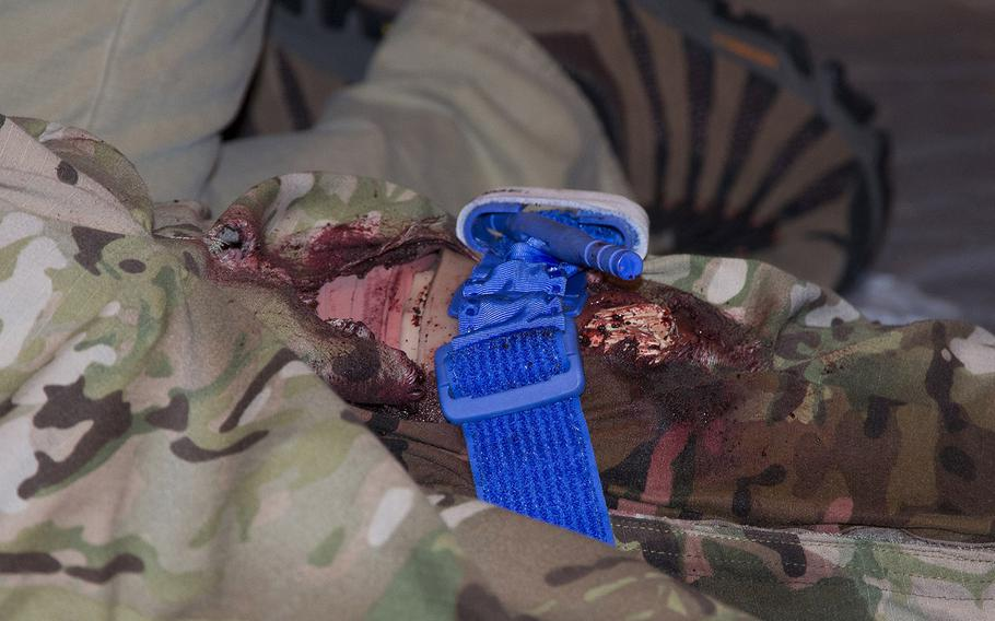 At a Capitol Hill demonstration Tuesday of new combat trauma training devices, former Navy corpsman Greg Figueroa finished tying a tourniquet on actor Johnny Wing???s leg and moved on to see what other damage might have been inflicted.