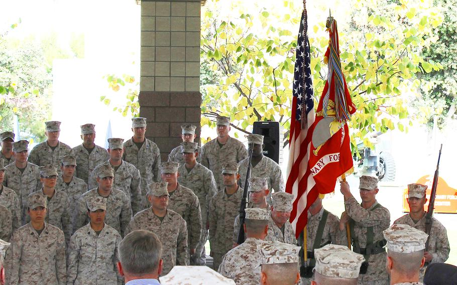 Marines unfurl the I Marine Expeditionary Force (Forward) colors Wednesday in a unit activation ceremony at Camp Pendleton, Calif. The unit will deploy to Helmand province, Afghanistan, in early 2014.