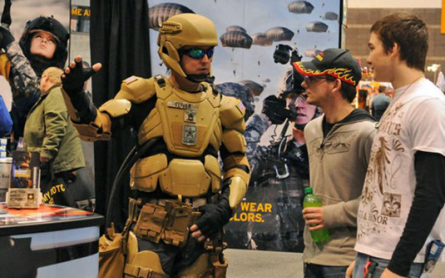 Sgt. 1st Class Matthew Oliver suits up in a futuristic combat uniform with a Tactical Assault Light Operator Suit-like look at the 2012 Chicago Auto Show.