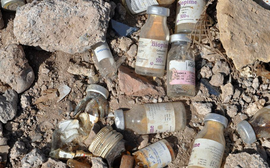 Discarded medicine bottles near Dahne Kamarkalagh, a colony of drug addicts on the outskirts of Herat, a city in western Afghanistan.