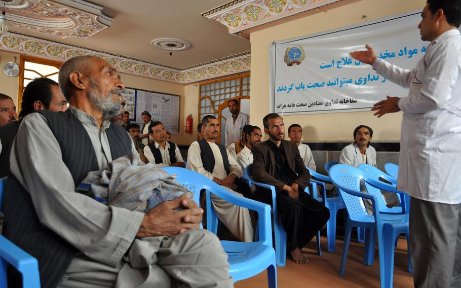 A doctor leads a motivational session for drug users at a rehabilitation clinic in Herat, Afghanistan. The western city is struggling with a major drug problem and has just eight clinics to serve an estimated 60,000 to 70,000 addicts.