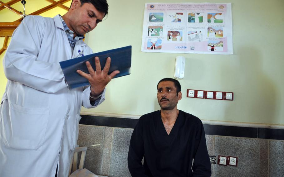 Najibullah, right, says he started using heroin 25 years ago while working in Iran. His story is similar to that of many Afghans, tens of thousands of whom travel each year to Iran, where heroin is cheap and readily available.
