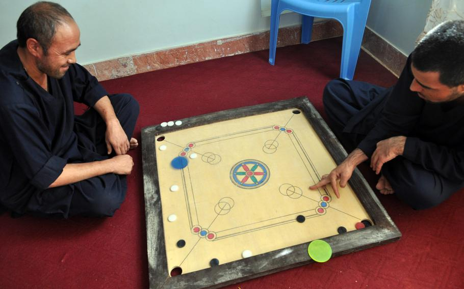 Patients play a game at a drug rehabilitation clinic in Herat, a city in western Afghanistan. The 45-day in-patient program includes heavy doses of motivational speaking and religion, but addicts must quit cold turkey, as no methadone is allowed.