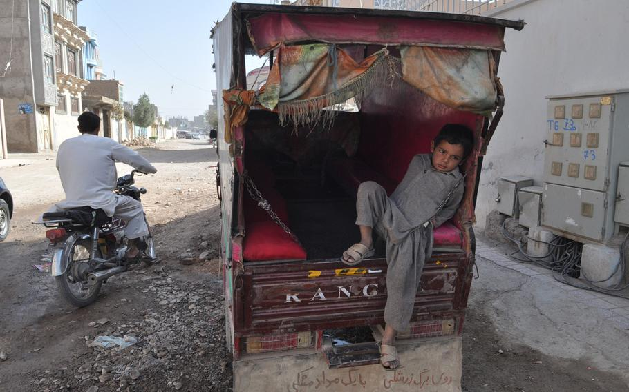 A young boy rests in a seh charkh (three wheels), the ubiquitous auto-rickshaws that ply the streets of Herat, a regional capital in western Afghanistan.