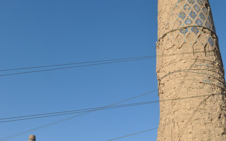 The minarets of the Musalla complex in Herat, Afghanistan. Steel cables have been installed to stabilize the minaret in the foreground, which is in danger of collapse.