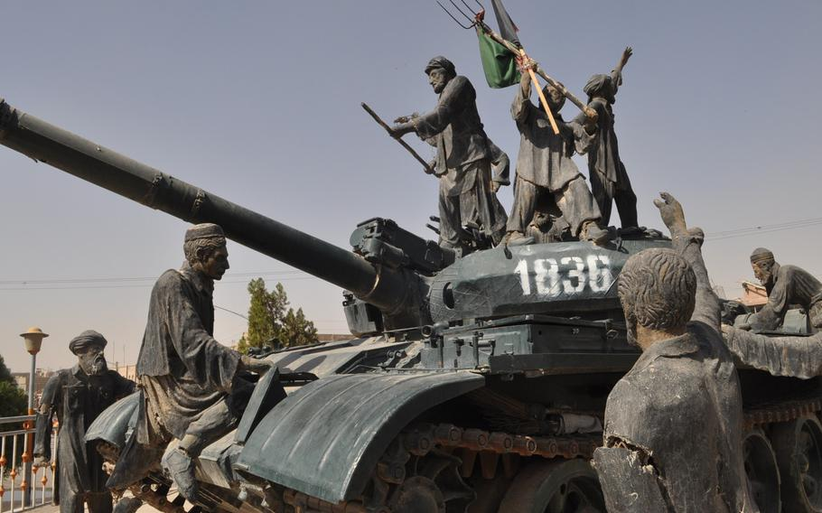 A Soviet tank adorns a busy traffic circle in Herat, Afghanistan, as a tribute to the Mujehideen, the guerrilla fighters who pushed the Soviet Red Army out of Afghanistan after a bloody 10-year war.
