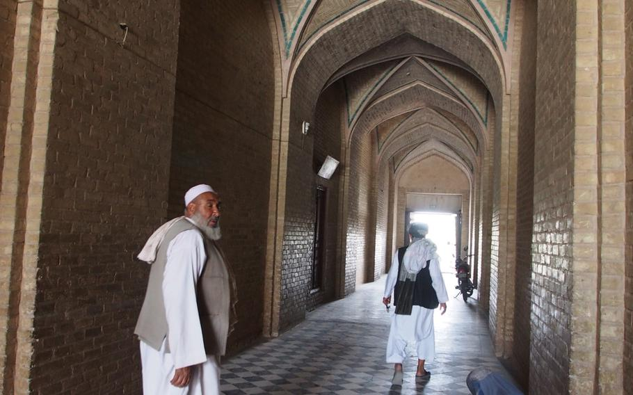 A woman begs in the entrance of the Jami Mosque in Herat, Afghanistan.