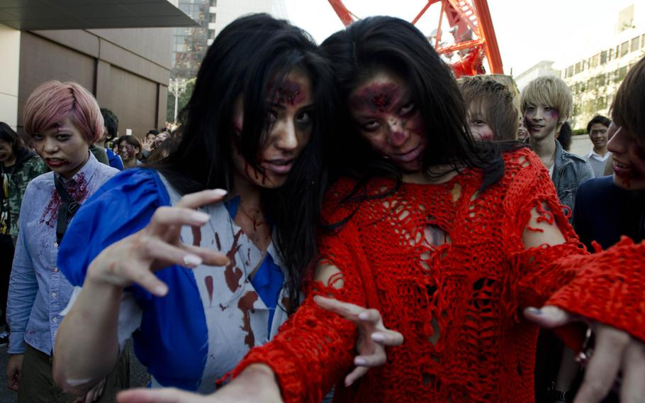 Zombies storm Toyko Tower as part of an event organized by Fox International Channels, Japan, to mark the beginning of the fourth season of ''The Walking Dead'' television show.