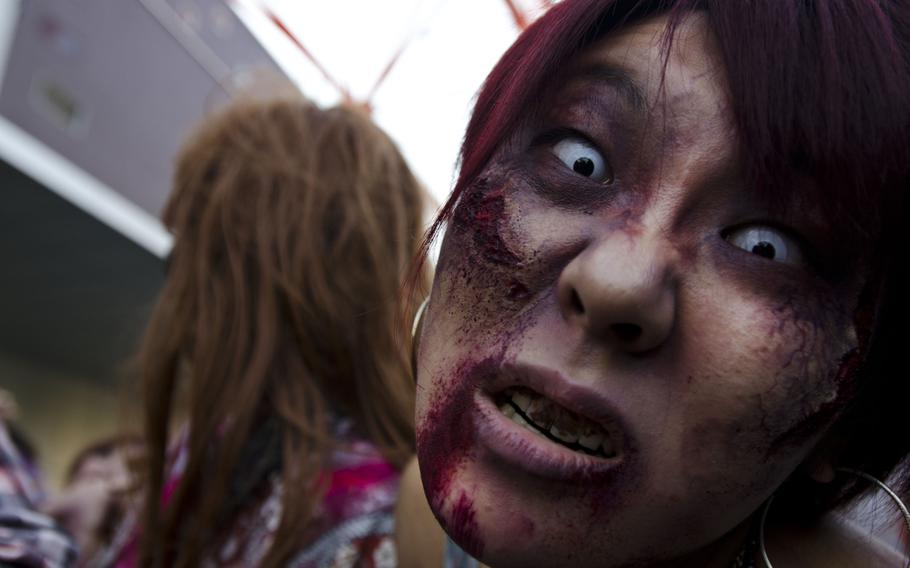 Zombies storm Toyko Tower on Halloween as part of an event organized by Fox International Channels, Japan, to mark the beginning of the fourth season of ''The Walking Dead'' television show.