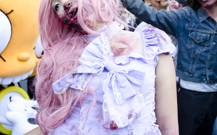 A well-dressed zombies makes her way to Toyko Tower on Halloween as part of an event organized by Fox International Channels, Japan, to mark the beginning of the fourth season of ''The Walking Dead'' television show.
