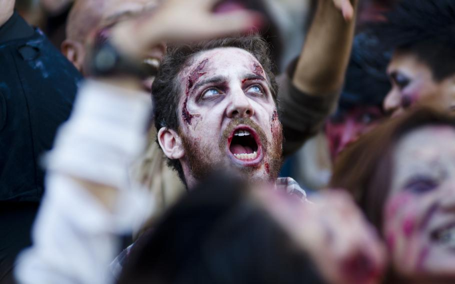 Zombies storm Toyko Tower on Halloween.