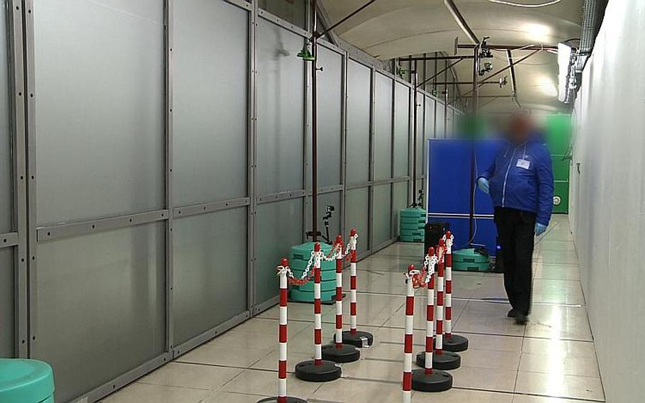 Working in real time, the video surveillance system from NATO's Stand-off Detection of Explosives program picks out a suspicious individual among the passengers in the corridors of a public transport building. An image of the person appears on the operator's screen.