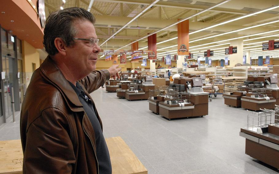 Harry Nichols Jr., the Ramstein commissary director, points to a line of new registers in the remodeled and expanded store on Ramstein Air Base, Germany. The renovated facility is scheduled to open Nov. 15.