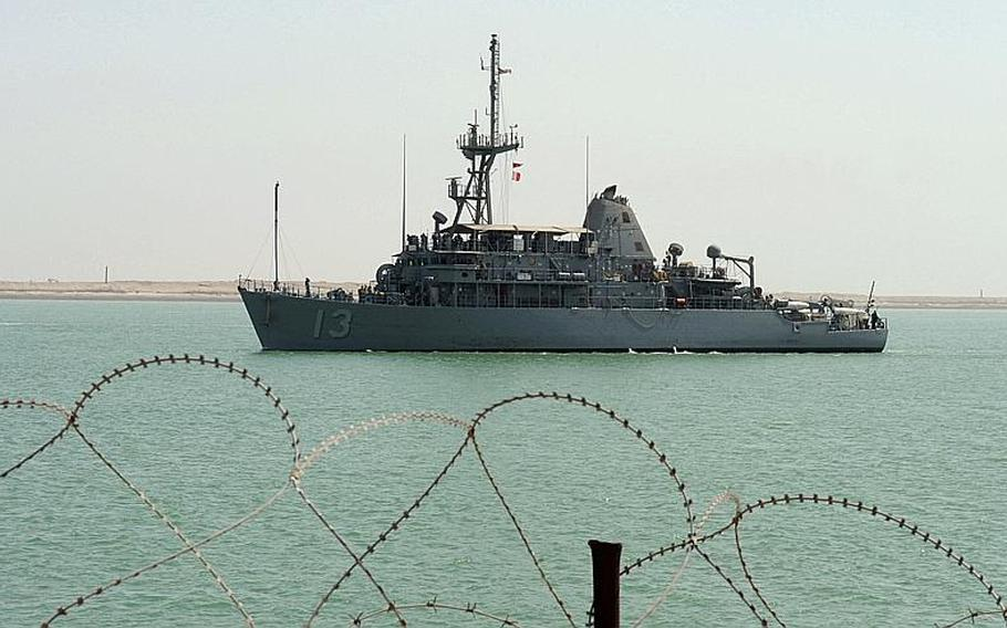 """The mine countermeasures ship USS Dextrous approaches the Iraqi navy pier in Umm Qasr, Iraq.  The commander of the Bahrain-based vessel was relieved of his duties Wednesday ?due to loss of confidence in ability command."""""""
